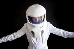 Astronaut in a helmet looks down. Fantastic space suit. Exploration of outer space. Royalty Free Stock Photography