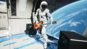 An astronaut on his spaceship plays space music on an electric guitar. Looping animation for fantasy, science fiction