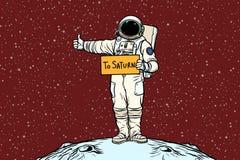 Astronaut hitch rides on Saturn. Pop art retro vector illustration Stock Photo