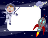 Astronaut Kid Photo Frame [1]. Photo frame, post card or page for your scrapbook. Subject: a boy and a rocket in the space with stars and a planet. Eps file Stock Photos