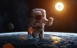 Astronaut. Landscape of Earth. Sun. Moon. Solar System. Elements of the image are furnished by NASA