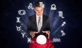 Astronaut looking for inspiration in his crystal magic ball stock photo