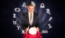 Astronaut looking for inspiration in his crystal magic ball royalty free stock photos