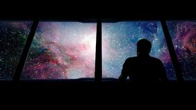 Astronaut Looks Out Approaching Galaxy stock video footage