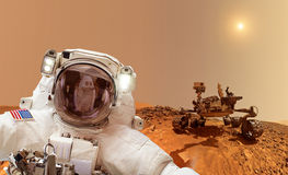 Astronaut on Mars - Elements of this image furnished by NASA. Astronaut on the surface of planet Mars, in background a rover Stock Image