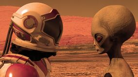 Astronaut meets a Martian on Mars. First contact. Alien on Mars. Exploring mission to mars. Colonization and space