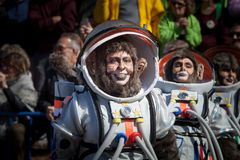 Astronaut monkey in Carnival. Badajoz, Spain - March 2, 2019: Performers with costumes inspired in astronaut monkey take part in the Carnival parade of comparsas royalty free stock photos