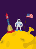 Astronaut on  moon. Cosmic man with the flag of America and rock Stock Photo