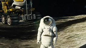 An astronaut on the moon next to his moon rover watching the Earth. HD An astronaut on the moon next to his moon rover watching the Earth stock video footage