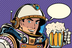 Astronaut with a mug of foaming beer Stock Photo