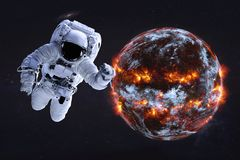 Astronaut near Planet Earth explosion with fire. Astronaut near Planet Earth explosion in the outer space. Humanity end. Planetary death concept. Elements of royalty free stock photos