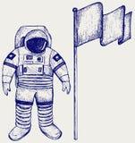 Astronaut och flagga Arkivfoton