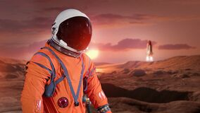 Free Astronaut On Surface Of Red Planet Mars.Elements Of This Image Furnished By NASA. Stock Photography - 187449102