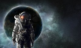 Astronaut explorer in space. Mixed media Royalty Free Stock Image