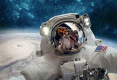 Astronaut in outer space against the backdrop of the planet eart royalty free stock images