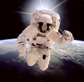 Astronaut in outer space. Against the backdrop of the planet earth. Elements of this image furnished by NASA Stock Photos