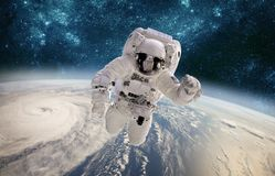 Astronaut in outer space against the backdrop of the planet earth. Typhoon over planet Earth royalty free stock photos