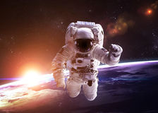 Astronaut in outer space against the backdrop of Royalty Free Stock Images