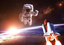 Astronaut in outer space against the backdrop of Royalty Free Stock Photo