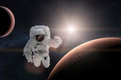 Astronaut in outer space on background of the Mars. Elements of this image furnished by NASA Royalty Free Stock Photos