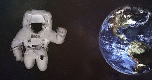 Astronaut in outer space with Earth. Elements of this image were furnished by NASA. stock image