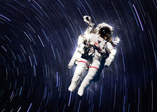 Astronaut in outer space. Elements of this image furnished by NASA Stock Images