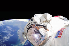Astronaut in outer space - Elements of this image furnished by NASA. Astronaut in outer space, in background our earth Royalty Free Stock Photography