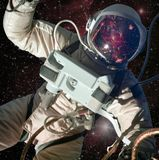 Astronaut in outer space with galaxy reflection on the helmet. royalty free stock photography