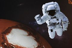 Astronaut in outer space with Mars planet of solar system with reflection in helmet. Science fiction wallpaper. Astronaut in outer space with Mars planet of stock image