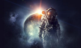 Astronaut in outer space. Mixed media. Astronaut in space suit. Elements of this image furnished by NASA royalty free stock photos