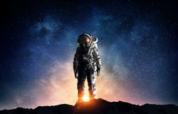 Astronaut in outer space. Mixed media. Astronaut in space suit. Elements of this image furnished by NASA stock photos
