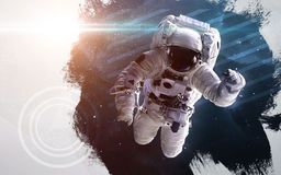 Astronaut in outer space modern art. Elements of this image furnished by NASA. Royalty Free Stock Images