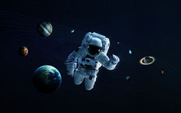 Astronaut in outer space modern art. Elements of this image furnished by NASA. Solar system and space objects in space. Elements of this image furnished by NASA Royalty Free Stock Photography