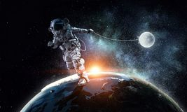 Fantasy image with spaceman catch planet. Mixed media Stock Photography