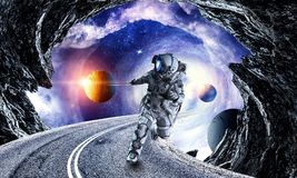 Fantasy image with spaceman catch planet. Mixed media. Astronaut in outer space pulling planet on rope. Elements of this image are furnished by NASA Stock Photo