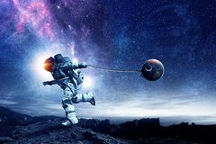 Fantasy image with spaceman catch planet. Mixed media Royalty Free Stock Photo
