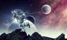 Fantasy image with spaceman catch planet. Mixed media Royalty Free Stock Image