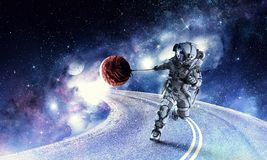 Fantasy image with spaceman catch planet. Mixed media Stock Photos
