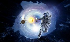 Fantasy image with spaceman catch planet. Mixed media Royalty Free Stock Photos