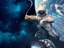 Astronaut in outer space. With spaceship against the backdrop of the planet Earth Stock Photo