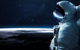 Astronaut in outer space. Spacewalk. Elements of this image furnished by NASA Royalty Free Stock Photo