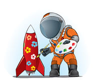 Astronaut painting the rocket. Astronaut painting flowers on the rocket Royalty Free Stock Images