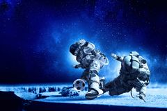 Astronaut play soccer game Royalty Free Stock Image