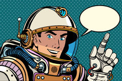 Astronaut pointing finger direction. Pop art retro style. the pointer gesture of the hand. Index finger Stock Photos