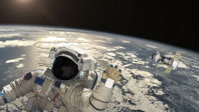 Astronaut and satellite above the Earth stock video footage