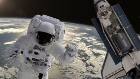 Astronaut and shuttle above the Earth stock video footage