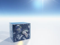 Astronaut and space captured. In clear box in surreal scene Stock Images