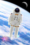 Astronaut explorer. Astronaut on the space with earth and moon and several lights Stock Photos