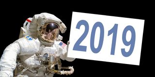 Astronaut in space holding a 2019 white board. Elements of this image are provided by NASA stock photos