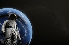 Astronaut on space mission flying around our blue planet. Earth on background. Cosmos. 3D illustration.  Royalty Free Stock Images